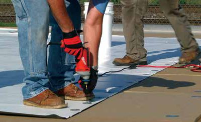 image shows commercial roof installers from Highland Residential and Commercial Roofing